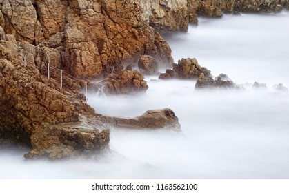 waves motion on the cliff