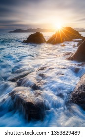 Waves motion and sunset on the french coastline