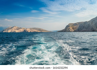 Waves on adriatic sea behind the ship. In the left side the mountains on island Prvic in Croatia. Suitable as cruise background
