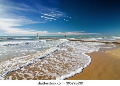Waves on the beach of Lido di Jesolo near Venice, Veneto region, Italy.