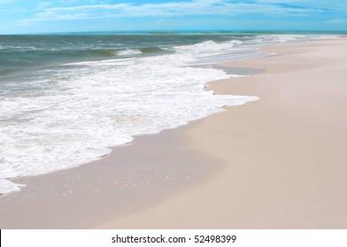 Waves on beach on pretty gulf coast