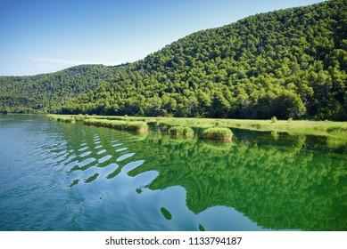 Waves on Krka river water at Skradin, Croatia