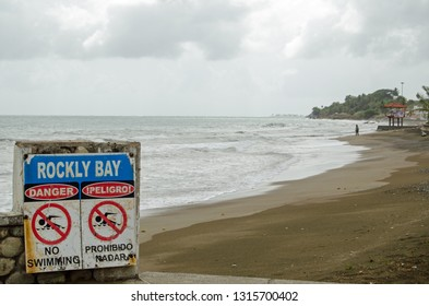 Waves on Rockly Bay, Scarborough on a cloudy afternoon on the island of Tobago, Trinidad and Tobago.