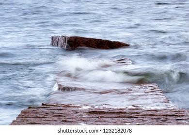 Waves on submerged stone dock