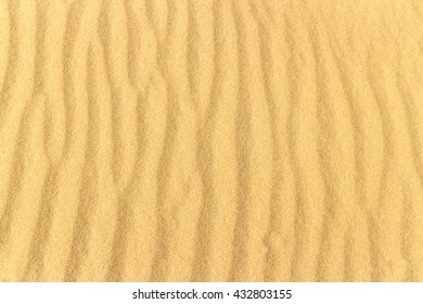 waves on the yellow sands of the desert