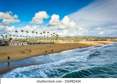 Waves in the Pacific Ocean and view of the beach from Balboa Pier in Newport Beach, California
