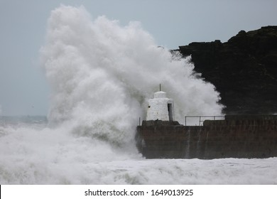 Waves pound against the harbour wall at Portreath, Cornwall, as the UK is hit with weather disruption for the second weekend in a row as Storm Dennis sweeps in.