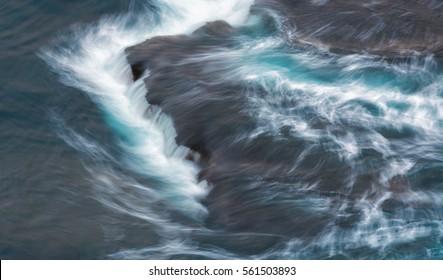 Waves rushing over rocks