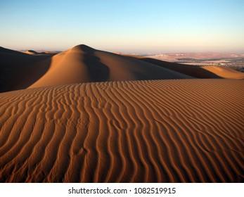 Waves of sand in Rub al Khali desert in UAE