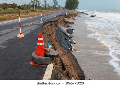 Waves of sea erode the road.
