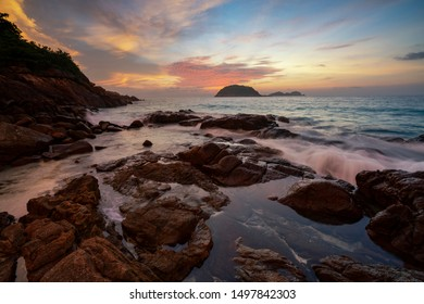 Waves smashing on rocks by the seaside in Redang Island, Terengganu, Malaysia during sunrise.