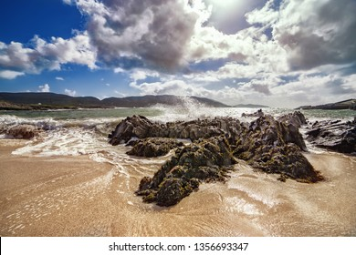 Waves splashes on a beach in County Cork. Allihies, south west of Ireland.