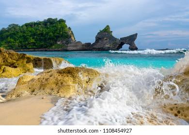 Waves splashing on the Atuh beach in the Nusa Penida island near Bali, Indonesia