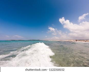 Waves splashing on the beach at sardinia coastline