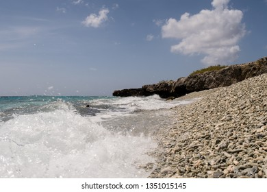 Waves and spray in the surf on a beautiful and idyllic coral beach on the west coast of the tropical island Bonaire in the former Dutch Antilles in the caribbean