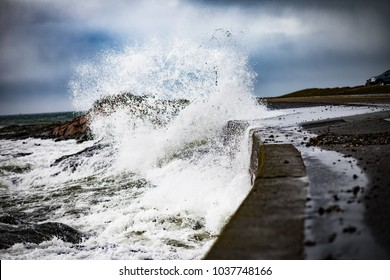 Waves and storm surge crash over Ocean Drive in Newport Rhode Island. The waves were after the March 2 Nor'easter that hit the East Coast. Powerful waves crash against the seawall and into the road