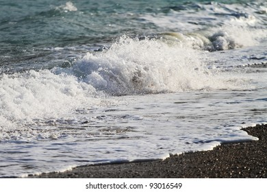 waves sweep across the beach