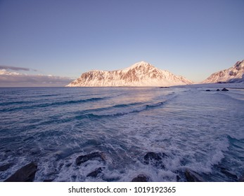Waves swelling at a beach in lofoten by winter