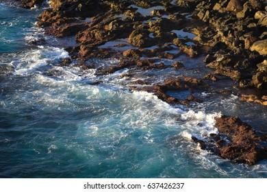 waves towards rocky beach