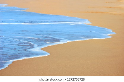 Waves wash ashore at Polihale State Park on the Island of Hawaii.