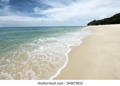 Waves washing onto sandy beach