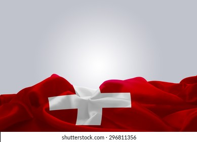waving abstract fabric Switzerland flag on Gray background