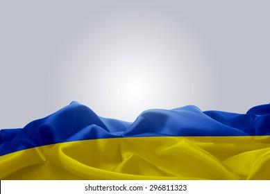 waving abstract fabric Ukraine flag on Gray background