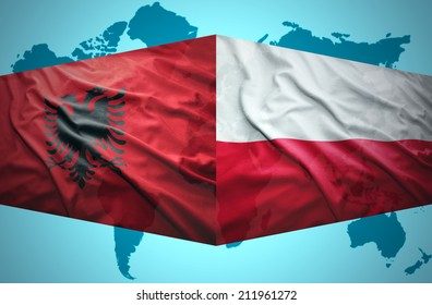 Waving Albanian and Polish flags of the political map of the world