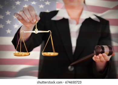 Waving American flag against midsection of female holding scales of justice and gavel