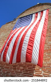 Waving American Flag on the brick wall