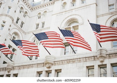 Waving American Flags Hang from Stone Building