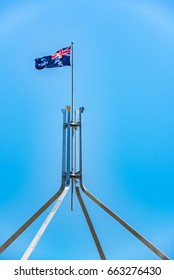 Waving Australian flag on the Parliament House Canberra at Australian Capital Territory