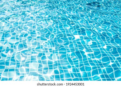 Waving blue water surface. blue clear fresh Water in jacuzzi
