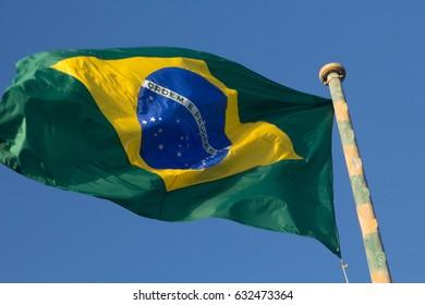 waving brazilian flag with blue sky