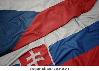 waving colorful flag of slovakia and national flag of czech republic. macro
