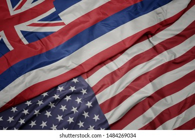 waving colorful flag of united states of america and flag of hawaii state. macro