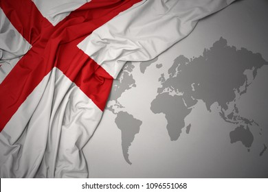 waving colorful national flag of england on a gray world map background.