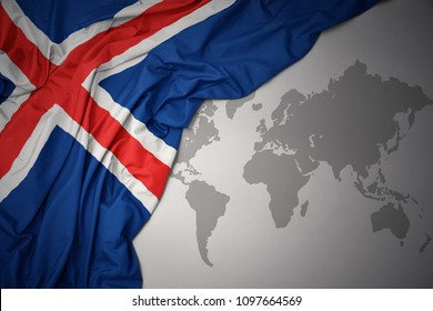 waving colorful national flag of iceland on a gray world map background.