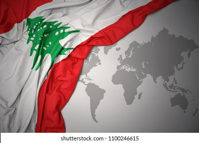 waving colorful national flag of lebanon on a gray world map background.