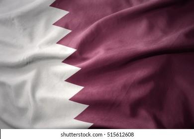 waving colorful national flag of qatar.