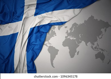 waving colorful national flag of scotland on a gray world map background.