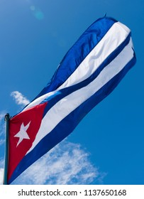 Waving Cuba flag and blue sky during sunny day