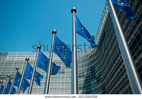 Waving European flags outside the Berlaymont building in Brussels