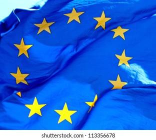 A waving European Union Flag in sunlight