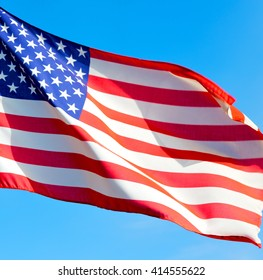 waving flag in the blue sky usa colour and wave