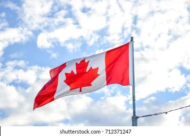 Waving flag Canada under the blue sky