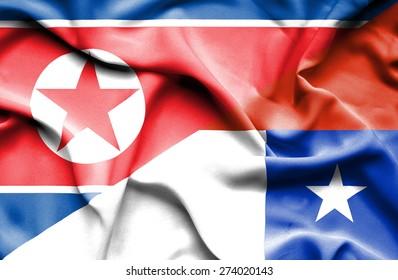 Waving flag of Chile and North Korea