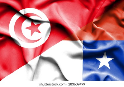 Waving flag of Chile and Tunisia