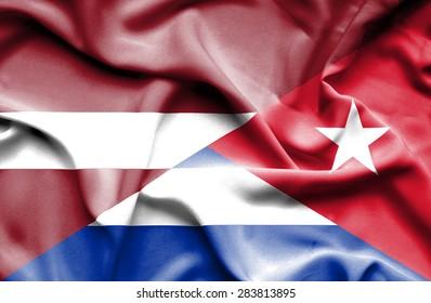 Waving flag of Cuba and Latvia