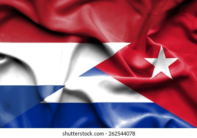 Waving flag of Cuba and Netherlands